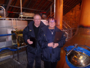 Liz and Paul iln the still room at The Speyside Distillery