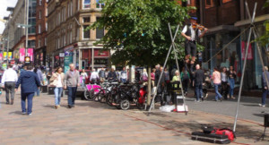 George Square in Glasgow, wire walkers and crowds