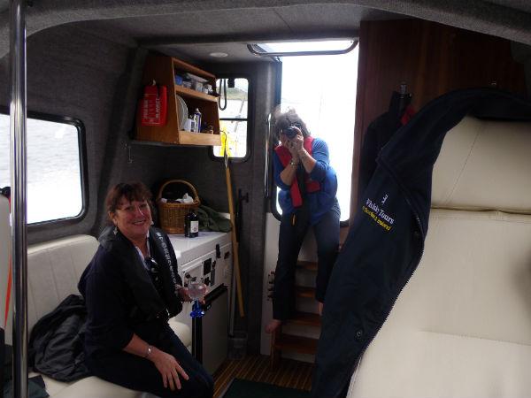 Liz drinking julie taking her photo and paul taking julie