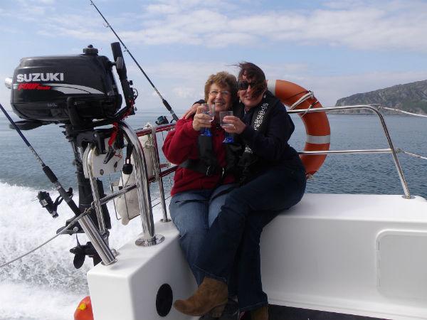 Lois and Liz enjoying a drink on the Jenny Wren