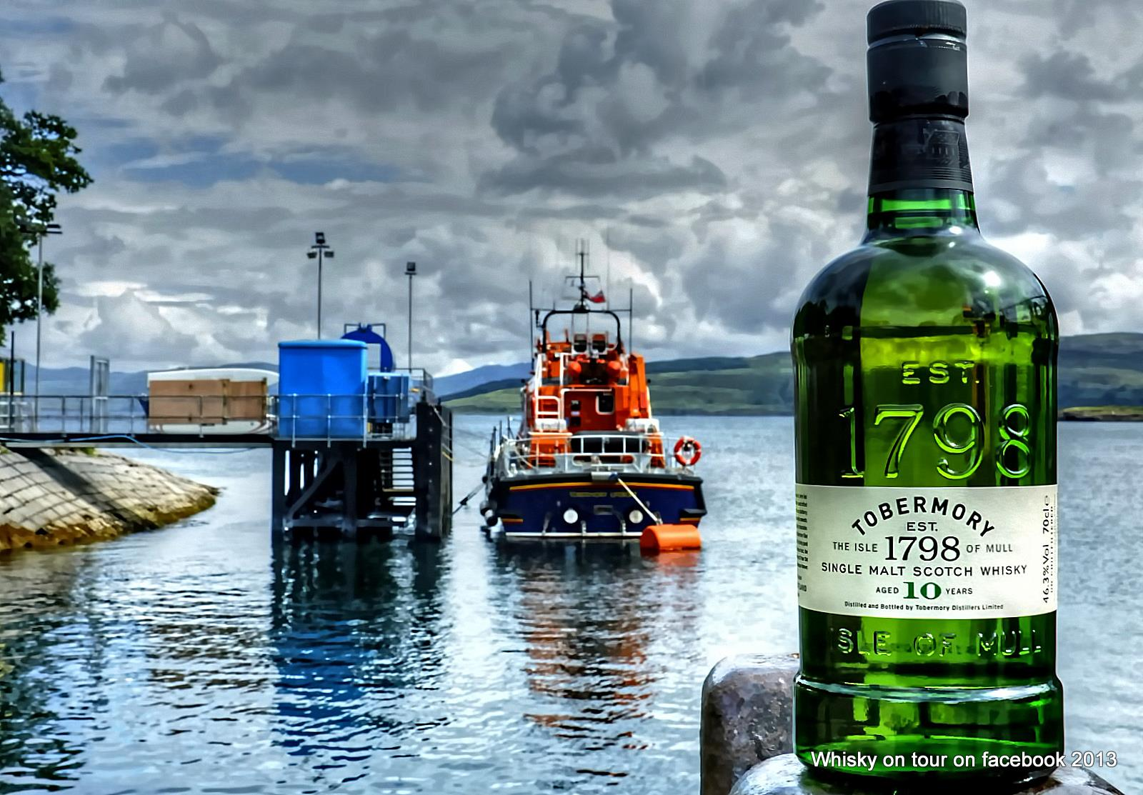 bottle of Tobermory whisky with a wrecked boat on the isle of Mulll