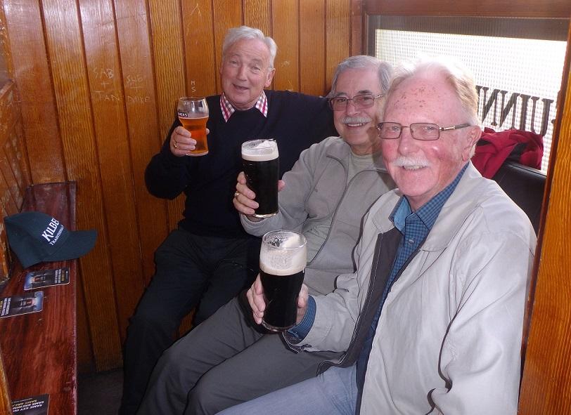 3 amigos having fun in Clarkes bar Drogheda Ireland